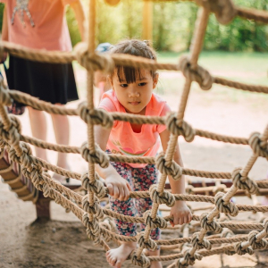 child with rope ladder