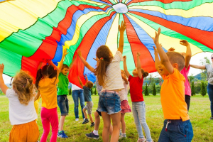 time to play - children under parachute