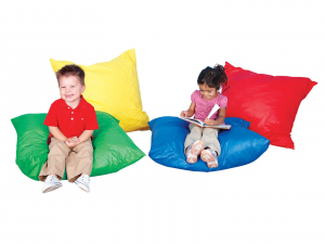 two students reading on beanbag pillows